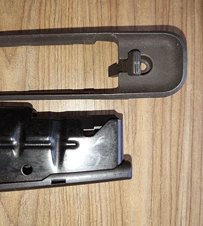Metal with a metal release in the rifle's stock