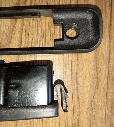 Plastic with a release tab on the magazine
